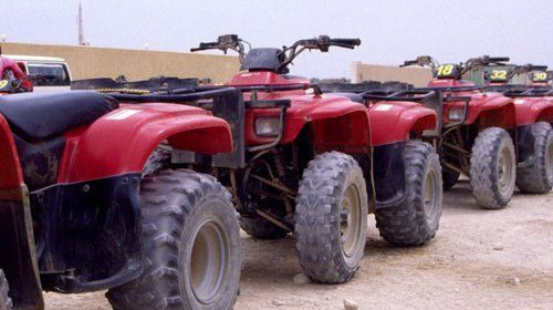 A row of red quad bikes