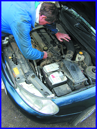 Garage services - Wormley, Broxbourne -Car-Mechanic-working on car engine - MANOR M.O.T.S