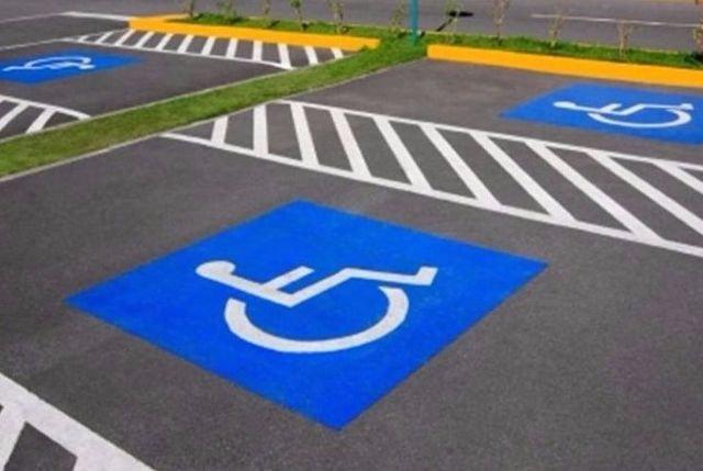 disabled bay markings in blue non slip thermoplastic