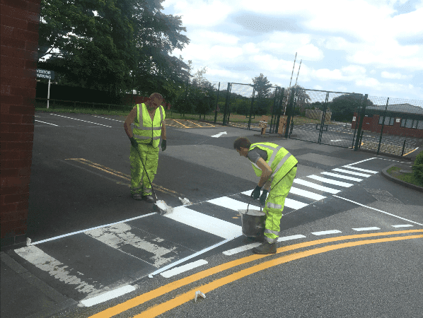 Zebra Crossing being created in white thermoplastic product