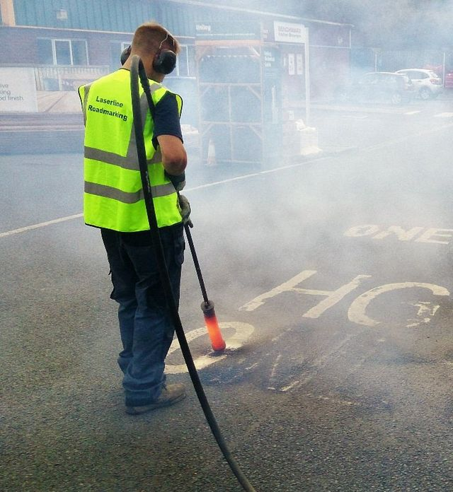 using gas lance to remove road markings