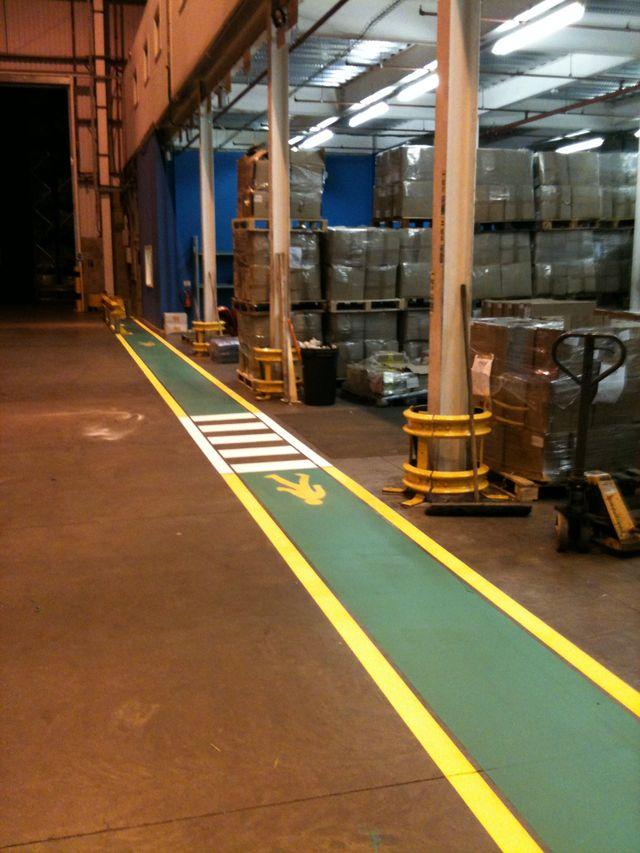 a machine spraying yellow line markings