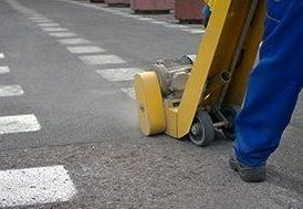 thermoplastic line marking removal using a scabbler