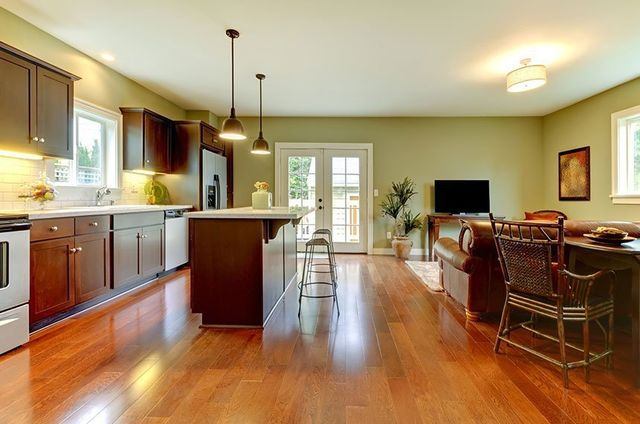Modern new brown kitchen with cherry floor