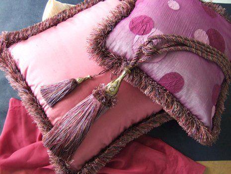 cuscino rosa e cuscino fucsia a pois