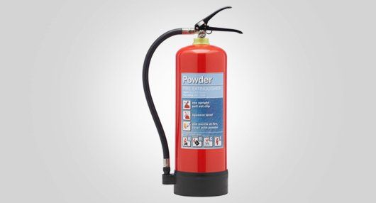 Powder dispensing extinguisher