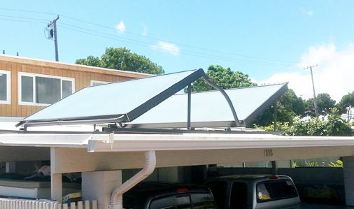 Two solar panels atop a garage roof