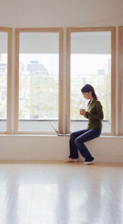 Women sitting next to the double glazed window