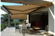 folding arm awnings over patio area