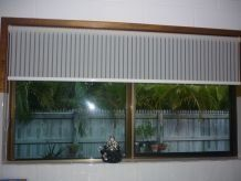 striped roller blinds on window