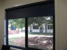 black roller blinds on glass door