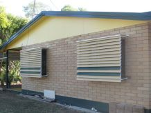side of building with sunbreeze awnings