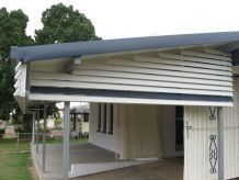 side of home with awning