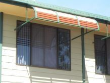 window with blinds and awning