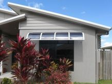 front window with partial translucent awning