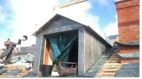 Man retiling roof