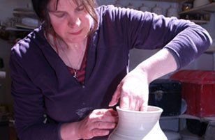 potter throwing a pot