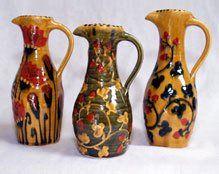 three decorated vases