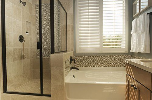 Bathroom with installed custom shutters