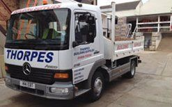 white coloured commercial vehicle