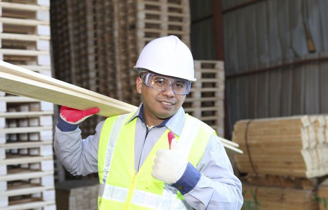 A worker gives the thumbs up