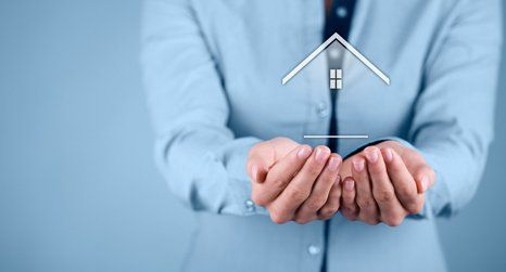 graphic of a person holding a home