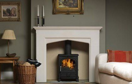 Wood burning stove in fireplace