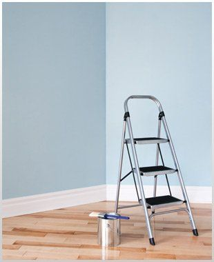 stepladder in a blue room with a wooden floor