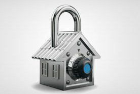 A house shaped padlock with a blue safe combination dial on the front