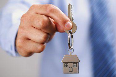 person handing a house keys
