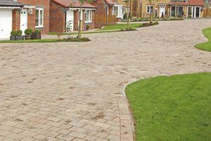 Curved paving along the front of a row of houses