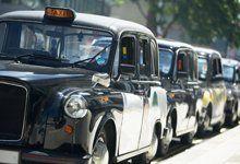 A row of black Hackney Cabs