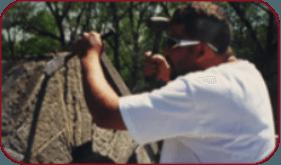 A man restoring a building