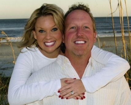 Dr Carmony and his wife show their white teeth
