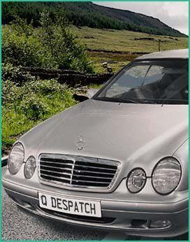 Silver car in scenic background