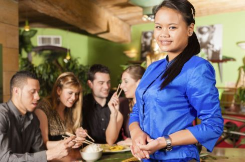 Woman serving guests