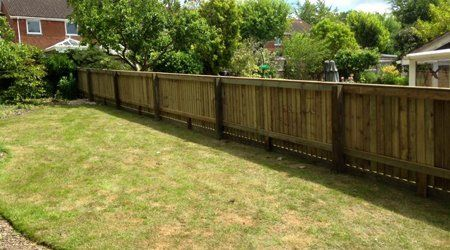 A long garden fence in pale wood