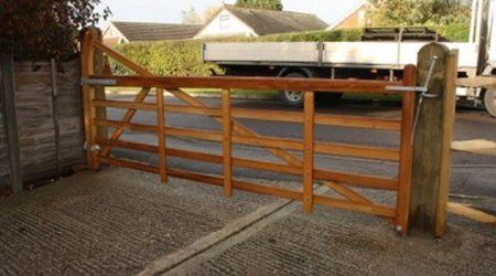 A long wooden farm gate