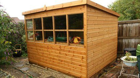 Timber garden shed with lattice window