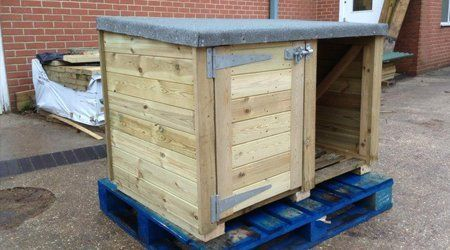 A pale wood log storage unit