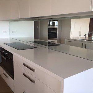 kitchen with a glass splashback