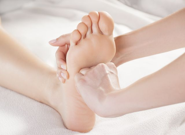 Pressure being applied to the sole of a foot