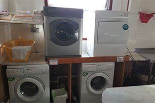 laundry room with multiple washing machines