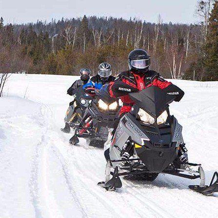 A convoy of snowmobiles