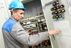 A person checking a fuse board