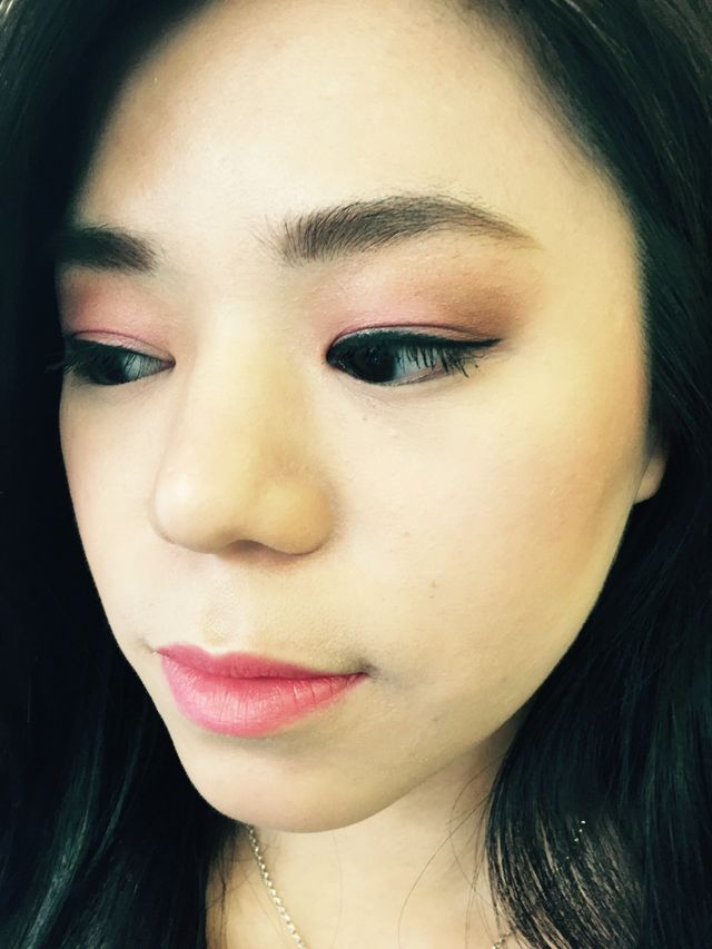 A happy client with pink eye shadow and subtle pink lips