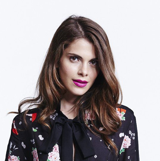 A brunette with bright pink lipstick