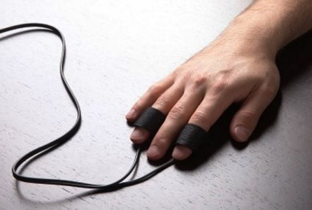 Man's finger connected with polygraph test wire