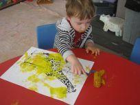 Boy painting giraffe