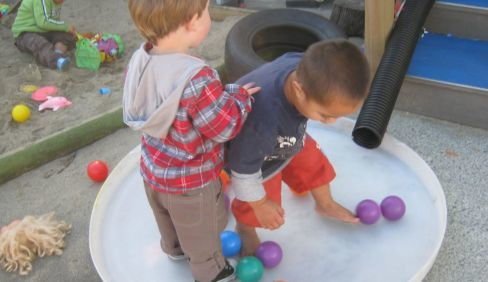 Kids playing with plastic balls